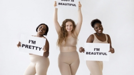 three-women-holding-placards-with-body-positivity-statements